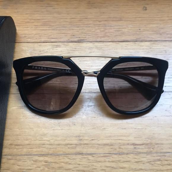 Prada black sunglasses with gold accents Cinema